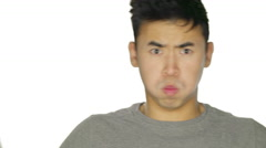 Young man making funny faces. - stock footage