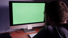 A man at the computer with green screen Stock Footage