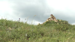 Mountain rock cairn, China Stock Footage