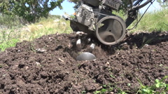 Close up shot of a tillage cultivator in operation. Slow motion clip. - stock footage