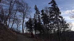 4k Woman relaxing bench mountain range Harz cold season Stock Footage