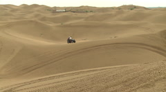Chinese men on dune buggy in Gobi Desert Stock Footage