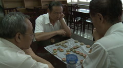 Chinese men playing checkers, Beijing Stock Footage
