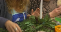 Adult Woman Chooses Fir Cone and Weaves Wire Inside Put it to the Christmas Stock Footage