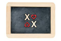 Wooden frame vintage chalkboard isolated on white with text XOXO (kisses &amp - stock photo