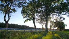 Secondary road with light traffic in the countryside slow pan Stock Footage