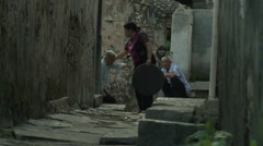 Old Chinese man, village alley, China Stock Footage