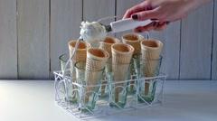 Female hand puts ice cream in cones Stock Footage