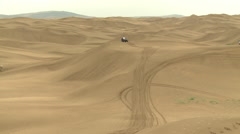 Buggy driving through Gobi Desert sand dunes Stock Footage
