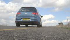 Israel, circa 2013. A blue Volkswagen Golf drives away from the camera Stock Footage
