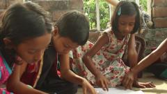 Female students smile and draw at a school for underprivileged kids in Bengal Stock Footage