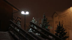 Snowing at night on the background of a lamppost Stock Footage