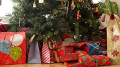 A dolly shot of christmas presents under the tree - stock footage