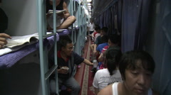 Crowded Chinese sleeper train, China - stock footage