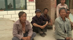 Mongolian men talking in village Stock Footage