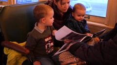 A family on a christmas train ride reads polar express Stock Footage