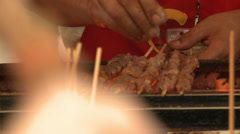 Cooking meat kebabs, Chinese food market Stock Footage