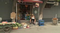 Grocery store in Beijing alley, China - stock footage