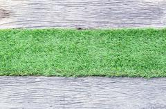 Grass green and wooden walkway. - stock photo