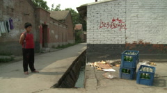 Boy in migrant worker village, Beijing China Stock Footage