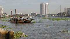 Ferry boats docked in Chao Praya river,Bangkok,Thailand Stock Footage