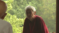Old Chinese man sitting in park, Beijing - stock footage