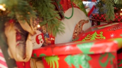 Dolly shot of the christmas presents under the tree - stock footage