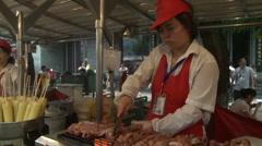 Chinese food cooking, meat kebabs, Beijing Stock Footage