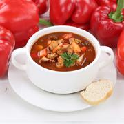 Healthy eating goulash soup with meat and paprika in cup Stock Photos