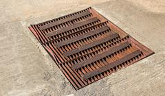 Sewer grate Stock Photos
