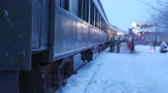 Families going on a Christmas train ride Stock Footage