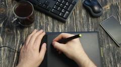 Graphic designer using digital tablet - stock footage