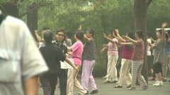 Public dancing exercise, Beijing park, China Stock Footage