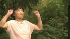 Chinese keep-fit instructor, Beijing park Stock Footage