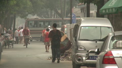 Beijing city life, alleyway, people, traffic - stock footage