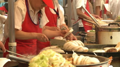 Chinese food, cooks, street market, Beijing Stock Footage