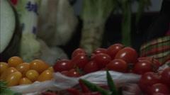 Chinese lady smiling, vegetable stall, China Stock Footage