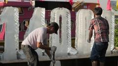Men making ice sculpture,Bangkok,Loi Krathong,Thailand Stock Footage