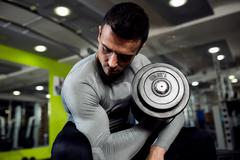 Strong powerful male exercise biceps - stock photo