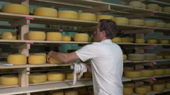 Cheese balls in aging room Stock Footage