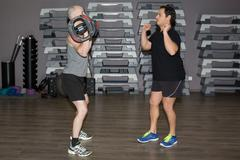 Fitness instructor at the gym  - Control your mind, conquer your body! Stock Photos