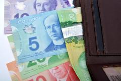 Canadian currency notes with perse Saving Concept Kuvituskuvat