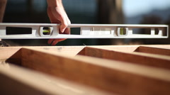 Checking level on 2x4 lumber frame Stock Footage