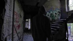 Slow motion of a bum walking in an abandoned house Stock Footage
