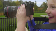 Close up of girl filming her family - stock footage