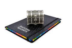 Success Secrets book with treasure box - stock photo