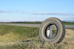 Rubber tire of a wheel at the intersection Stock Photos