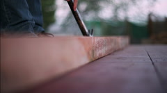 Pounding a nail into lumber framing - stock footage