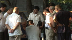 Watching Chinese checkers in park, Beijing Stock Footage