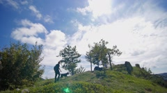 Slow motion of friends and dog on the top of a mountain Stock Footage